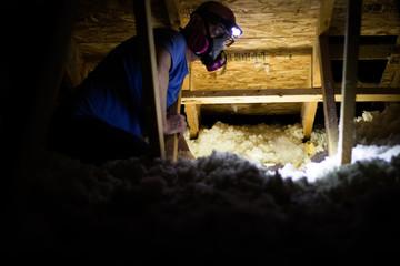 Obraz Working in a dark and dusty attic with insulation - fototapety do salonu