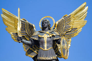 Golden statue of Archangel Michael at Independence Square in Kiev