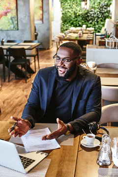 Decide whether or not the goal is worth the risks involved. If it is, stop worrying. African american businessman is working, using his laptop while resting in the cafe