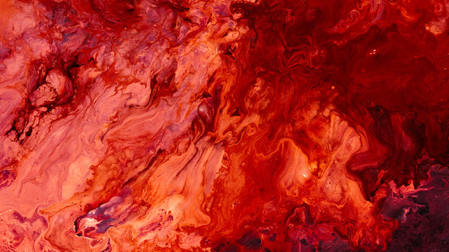 Abstract red paint background. Color gradient texture. Liquid mix fluid blend surface. Acrylic marble effect layer technique.