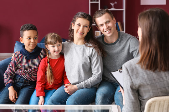 Social worker meeting with couple after adoption of children