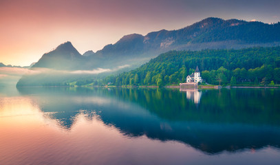Impressive sunrise of Grundlsee lake. Beautiful summer view of Gessl village, Liezen District of Styria, Austria, Alps. Europe. Beauty of countryside concept background.