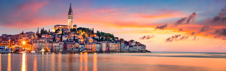 Fantastic spring sunset of Rovinj town, Croatian fishing port on the west coast of the Istrian peninsula. Colorful evening seascape of Adriatic Sea. Traveling concept background. Wall mural
