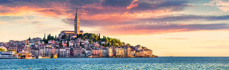 Printed kitchen splashbacks Beige Great spring sunset of Rovinj town, Croatian fishing port on the west coast of the Istrian peninsula. Colorful evening seascape of Adriatic Sea. Traveling concept background.