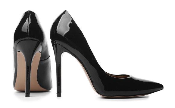 Stylish high-heeled female shoes on white background