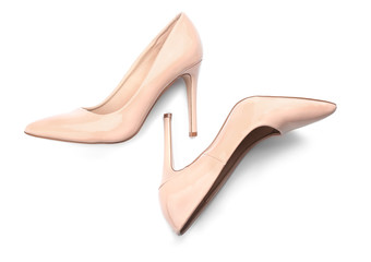 Pair of stylish high-heeled female shoes on white background
