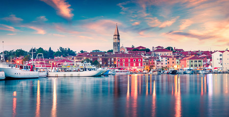 Splendid spring sunset of Rovinj town, Croatian fishing port on the west coast of the Istrian peninsula. Colorful evening seascape of Adriatic Sea. Traveling concept background. Wall mural