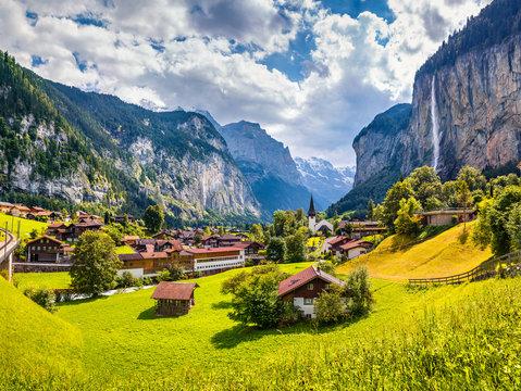 Sunny summer view of great waterfall in Lauterbrunnen village. Splendid outdoor scene in Swiss Alps, Bernese Oberland in the canton of Bern, Switzerland, Europe. Traveling concept background.