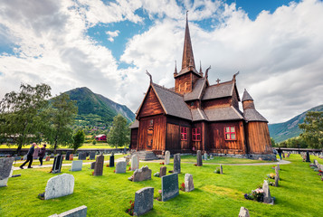 Picturesque summer view of Lom stave church (Lom Stavkyrkje). Sunny morning scene of Norwegian countryside, administrative centre of Lom municipality - Fossbergom, Norway, Europe.