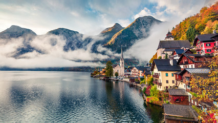 Goggy autumn scene of Hallstatt lake. Splendid morning viev of Hallstatt village, in Austria's mountainous Salzkammergut region, Austria. Beauty of countryside concept background. Wall mural
