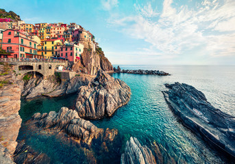 Second city of the Cique Terre sequence of hill cities - Manarola. Colorful spring morning in Liguria, Italy, Europe. Picturesqie seascape of Mediterranean sea. Traveling concept background.