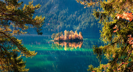 Picturesque autumn scene of Eibsee lake. Colorful morning view of small island on bottom of the Zugspitze peak, Bavaria, Germany, Europe. Beauty of nature concept background. Wall mural