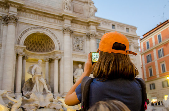 young woman taking a photo in Rome