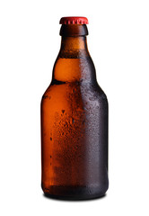 small bottle of beer with drops