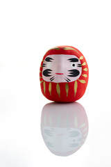 Traditional japanese Daruma doll symbol of fortune and luck isolated in white background