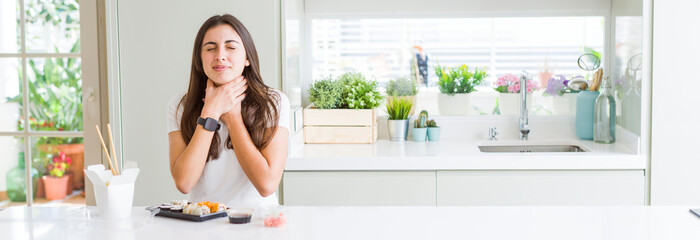 Wide angle picture of beautiful young woman eating asian sushi from delivery shouting and suffocate because painful strangle. Health problem. Asphyxiate and suicide concept.