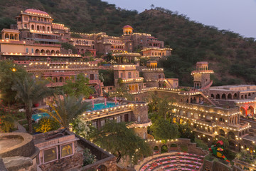 Neemrana Fort Palace at Night with lights in Rajasthan India