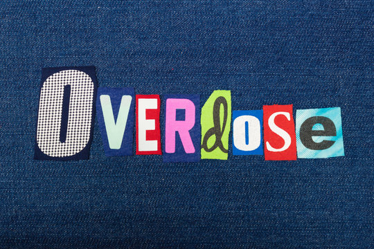 OVERDOSE text word collage, colorful fabric on blue denim, addiction and abuse concept, horizontal aspect