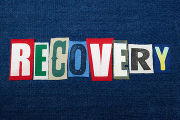 RECOVERY text word collage, colorful fabric on blue denim, rehabilitation and recovery, horizontal aspect