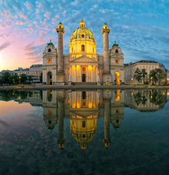 Amazing view of Karlskirche with illumination and reflection in the water, Vienna, Austria