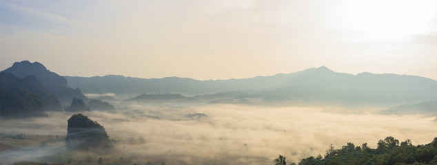 Spoed Fotobehang Beige Panoramic foggy landscape with mountains in morning
