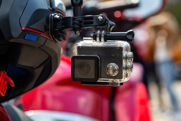 Action camera on a motorcycle rider's helmet