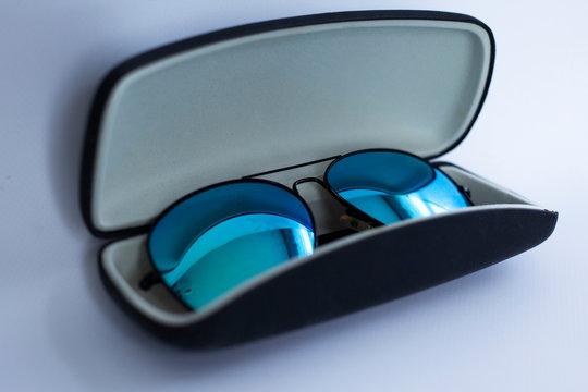 blue mirrored sunglasses in a case
