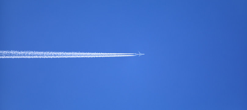 double track in the sky from a jet plane
