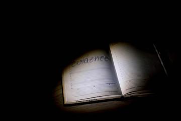 "The inscription ""Evidence"" under the light in the dark"