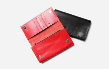 Stylish leather wallets on white background, top view