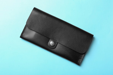 Stylish wallet on color background, top view
