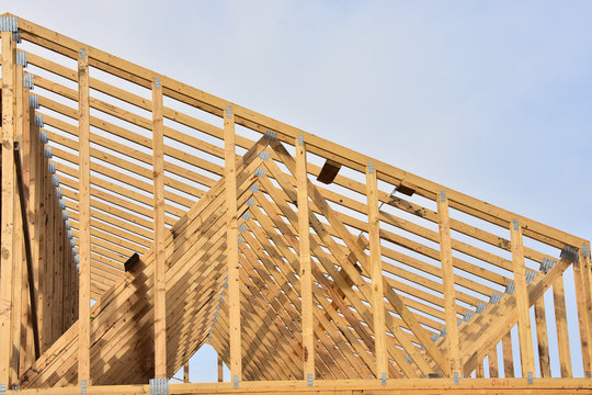 Close up of wood framing members of new home .