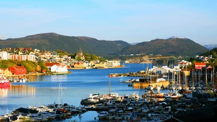 Wall Mural - Kristiansund, Norway. Aerial view of the city center of Kristiansund, Norway during the sunny day. Port with historical buildings, mountains at the background
