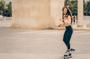 Girl roller skating in summer