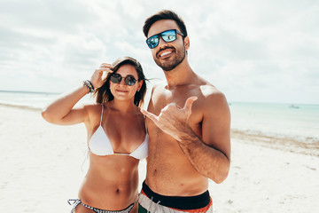 Young couple having fun on tropical beach