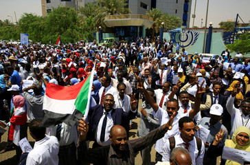 Members of Sudan's alliance of opposition and protest groups chant slogans outside Sudan's Central Bank during the second day of a strike, as tensions mounted with the country's military rulers over the transition to democracy, in Khartoum