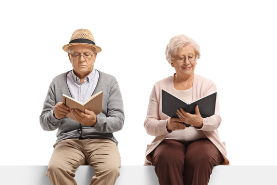 Elderly man and woman reading books