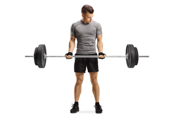 Young fit guy lifting weights