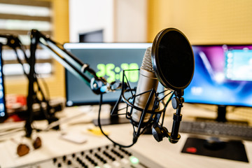 Microphone and mixer at the radio station studio broadcasting news