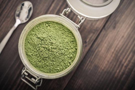 Moringa powder in glass jar