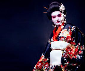 young pretty geisha in kimono with sakura and decoration