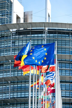 Vertical image flags of all member states of the European Union waving in calm wind in front of the Parliament headquarter on the day of 2019 European Parliament election