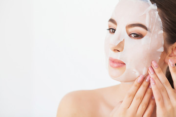 Skin Care. Young Female Removing Mask From Facial Skin. Woman Beauty Face