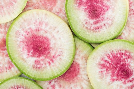 close up view of cut raw purple fresh watermelon radish slices