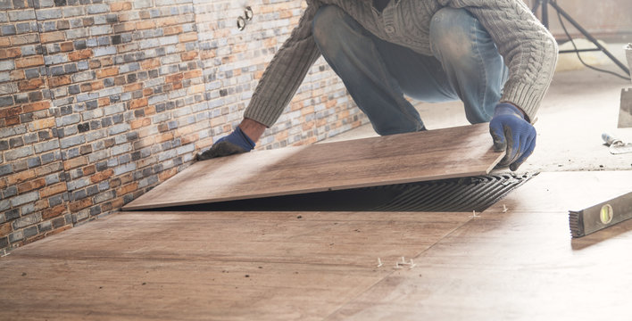 Laying floor ceramic tile. Renovating the floor