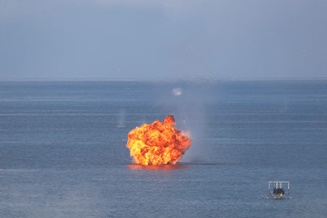 Explosions are seen at a target during the live fire Han Kuang military exercise, which simulates China's People's Liberation Army (PLA) invading the island, in Pingtung