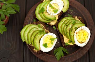 avocado. sandwich with avocado and egg. breakfast. healthy food.
