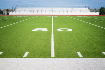 50 yard line on empty American football field stadium in Texas