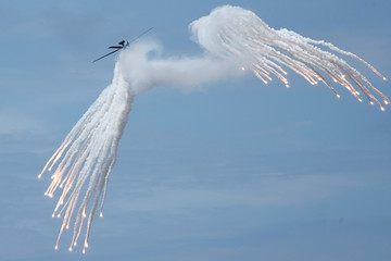 An AH-1W attack helicopter releases flares during the live fire Han Kuang military exercise, which simulates China's People's Liberation Army (PLA) invading the island, in Pingtung