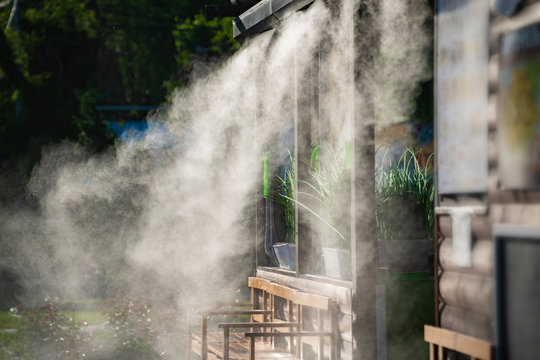 water spray system for cooling in a public cafe at the boiling hot summer days